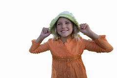 Girl holding hat, smiling, cut out Stock Photo