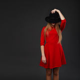 Girl holding hat up to face Royalty Free Stock Image