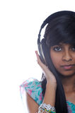Girl Holding Headphones Royalty Free Stock Images