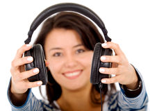 Girl holding headphones Stock Images