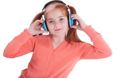 Girl  holding the headphones and smile Royalty Free Stock Photography