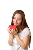 Girl holding a heart. Girl holding a red heart isolated on white Stock Photography