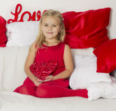 Girl in a holding a heart Royalty Free Stock Images