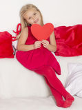 Girl in a holding a heart Stock Image