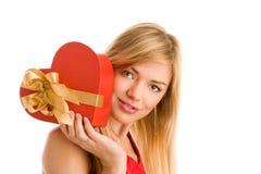 Girl holding heart gift Stock Image