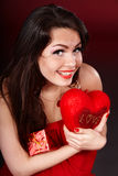Girl holding heart  and gift box . Stock Photography