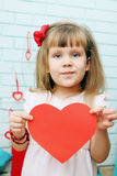 Girl holding heart in hands Royalty Free Stock Images