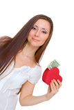 Girl holding a heart with money. Isolated on white Royalty Free Stock Photo