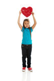 Girl holding heart pillow Royalty Free Stock Photos