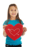 Girl holding heart pillow Stock Photos