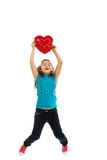 Girl holding heart pillow Stock Photography