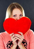 Girl holding a heart Stock Images