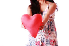 Girl holding heart shape balloon Stock Photos