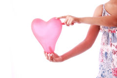 Girl holding heart shape balloon Royalty Free Stock Photo