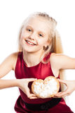 Girl holding a heart-shaped biscuit Royalty Free Stock Images