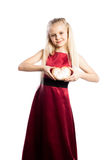 Girl holding a heart-shaped biscuit Royalty Free Stock Image