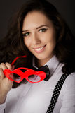 Girl Holding Heart-Shaped Glasses Stock Image