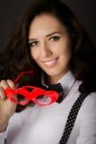 Girl Holding Heart-Shaped Glasses Stock Image