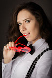 Girl Holding Heart-Shaped Glasses Royalty Free Stock Photo