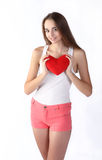 Girl holding heart toy Stock Images