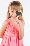 Girl holding a heart Royalty Free Stock Images