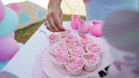 The girl holding the hearts on sticks, cakes in candy bar. Event. Tasty treat stock video