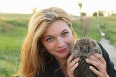 girl holding a hedgehog Stock Images