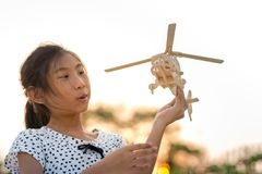 Girl Holding Helicopter Wooden Plane Toy Stock Photo