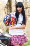 Girl holding a helmet Stock Photos