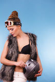 Girl is holding helmet and wearing goggle. Royalty Free Stock Photography