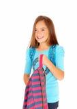 Girl holding her backpack. Stock Image