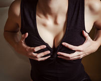 Girl holding her breasts. Closeup Stock Photos