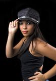 Girl holding her cap. Beautiful ethnic girl dressed in black, holding her cap Royalty Free Stock Photography