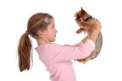 Girl holding her dog Stock Image