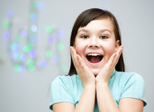 Girl is holding her face in astonishment Stock Photos