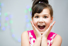 Girl is holding her face in astonishment Stock Images