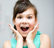 Girl is holding her face in astonishment Royalty Free Stock Images