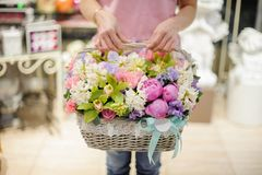 Girl holding a beautiful basket of white, pink and green spring flowers Stock Photography