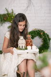 Girl holding in her hands a tray Christmas decoration Royalty Free Stock Photos