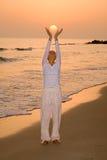Girl holding her own sun Stock Photo