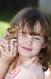 Girl holding her pet Hamster Stock Image