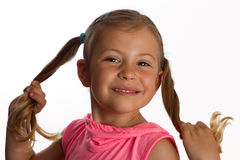 Girl holding her pony tails Stock Photography