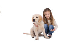Girl holding her puppy close royalty free stock images
