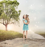 Girl Holding her Puppy at a Magical Brook Stock Images