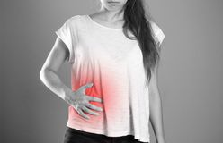 Girl holding her side. Pain in the liver. Syros liver. Close up. Isolated background stock photo