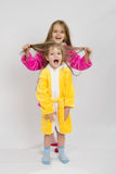 Girl holding her sisters wet hair Royalty Free Stock Image