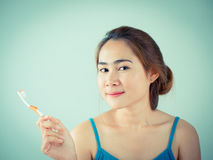 Beautiful girl holding her toothbrush Stock Images