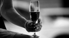 The girl is holding in his hand a glass of alcohol Stock Photo