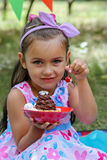 Girl holding holding delicious cake with cherry Stock Image