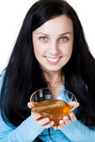 Girl holding honey bowl Royalty Free Stock Image